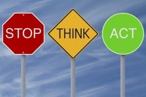 """Signs that say """"STOP, THINK, ACT"""""""
