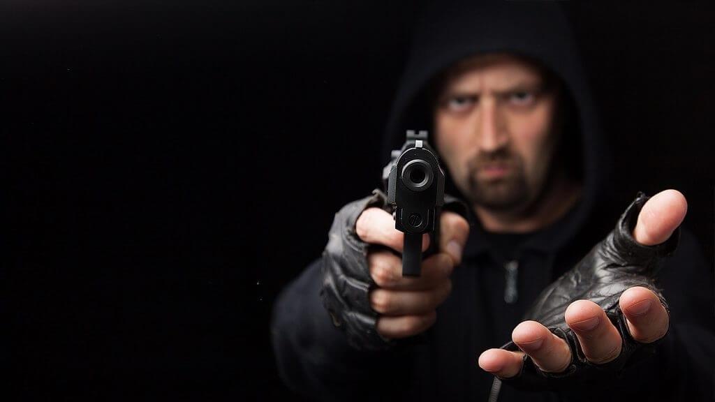 Man in black with a gun