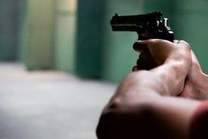 Closeup of man aiming a gun