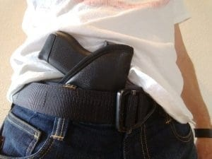 Gun in holster tucked into waistband