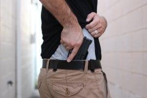 Man putting gun into waistband