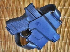 Photo of a glock in a holster, both blue