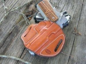 Firearm inside of red-brown holster