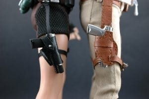 Closeup picture of male and female thigh holsters