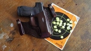 Weapon in holster with target behind it