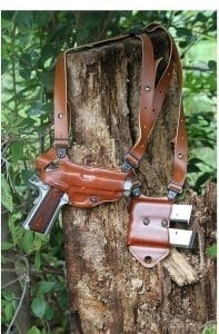 Brown weapon holster slung over tree stump